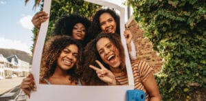 four women embracing cultural identity